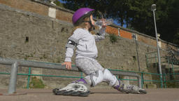 Attractive little girl in a helmet and protective gear Footage