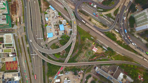 Aerial view of cars on highway junctions. Bridge roads in structure of architecture concept. Top Footage