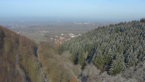 Aerial of two mountains with bare trees Footage