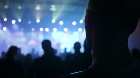 Young fan listening to music at a rock concert, Live Action