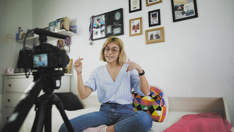 Young vloger making her video for blog. The girl turns on the camera and starts Live Action