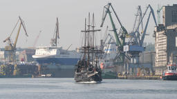 Galleon ship on a tour to Westerplatte. Gdansk shipyard in the background Live Action