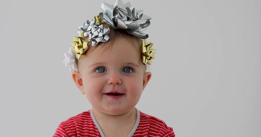 Baby decorated with a bow as a gift Footage
