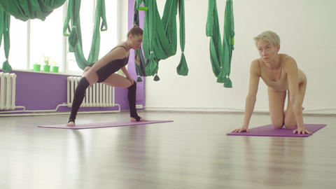 Young woman practicing yoga in bright studio Footage