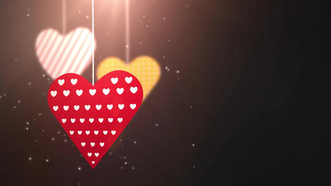 paper valentine hearts falling down hanging on string black background Animation