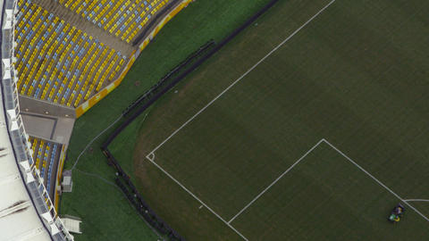 Aerial view of empty pitch, seats of football arena Footage