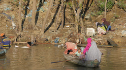 Muslim woman and child in canoe ferry,Battambang,Cambodia Footage