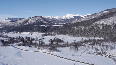 Aerial - Panorama of rural mountain region landscape covered in snow Footage