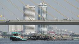 Small boat pulling barges on Chao praya river,Bangkok,Thailand Footage