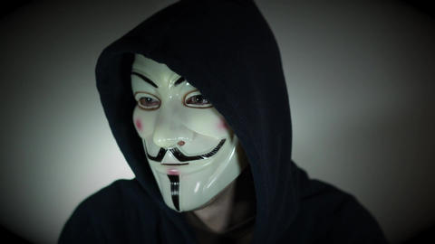 Scene of a masked Anonymous computer hacker Live Action