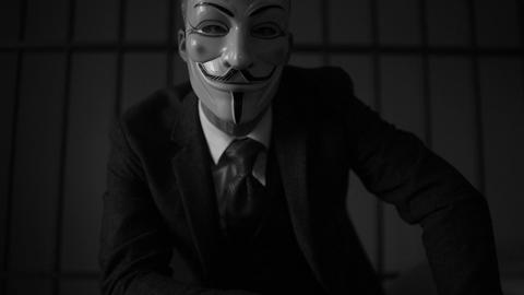 low dolly shot of Anonymous hacker in prison (B/W Version) Footage
