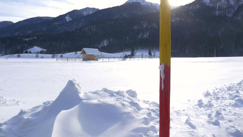 Red and yellow snow pole in a winter background Footage
