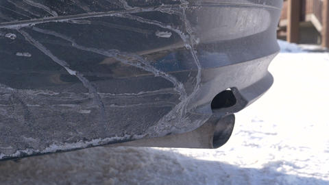 Closeup - Exhaust pipe. Car's engine starts and pipe shakes Footage