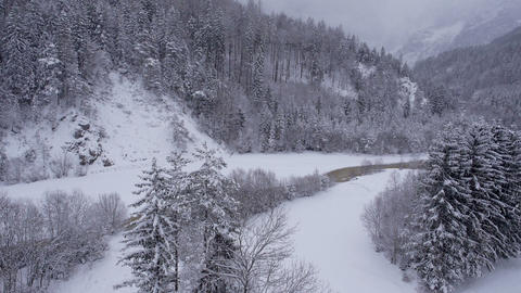 Aerial - Winter landscape with river running through the valley Footage