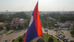 Lao national flag on top of Patuxai monument,Vientiane,Laos Footage