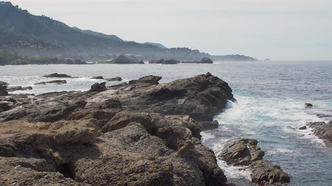 Large rugged rocks along the coast of California Big Sur Footage