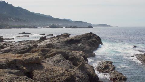 Large rugged rocks along the coast of California Big Sur Footage
