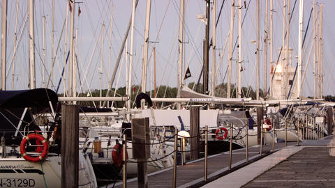 Static shot of sailboats docked in the marina at dusk Footage