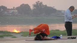 Woman Doing Yoga Exercises At Sunset,Vientiane,Laos stock footage