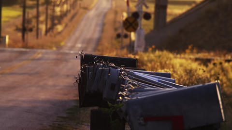 Static shot of country road, mailboxes and rail road crossing Footage