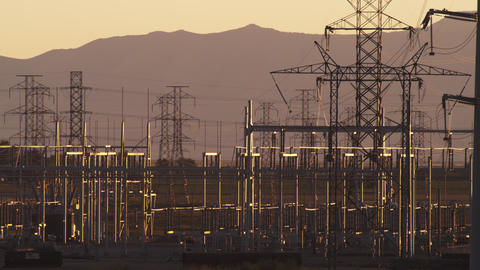 Static shot of power and electrical lines with mountains Footage