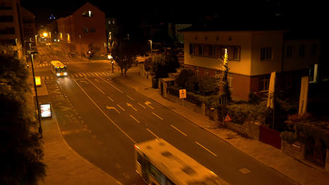 Aerial - Buses driving on city streets at night Footage