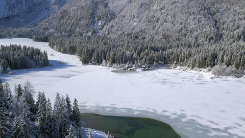 Aerial - High angle view of frozen lake and snowy mountains Live Action