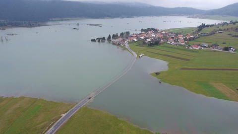 Aerial - Vehicle trying to cross the flooded road Footage