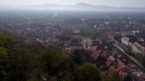 Aerial - View of a Ljubljana cityscape with morning mist above it Footage