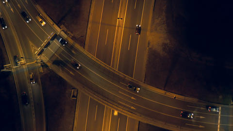 Aerial, vertical - Traffic at night. Roundabout over highway Footage