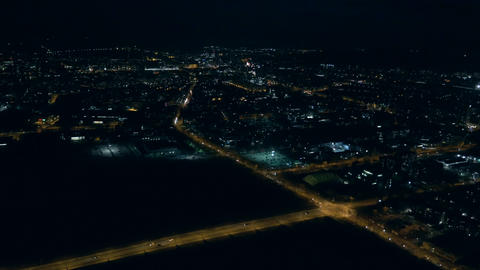 Aerial - Illuminated streets of a city at night Footage