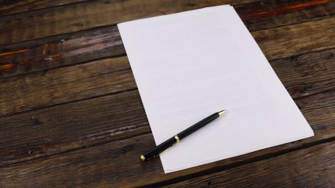 Rotation, pen lying on a clean sheet of paper, with copy space Footage