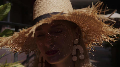 Fashion Portrait Of Beautiful Girl in straw hat outdoors Live Action
