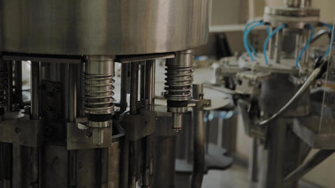 A stopped conveyor for bottling drinking water. Conveyor parts Live Action