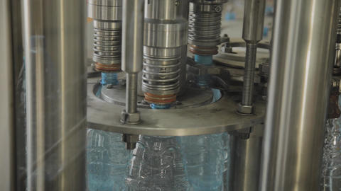 Production line of drinking water and carbonated drinks, the process of filling Footage