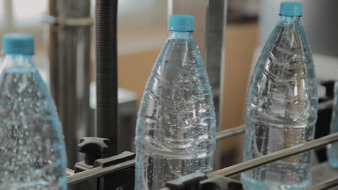 Plastic bottle manufacturing line. Plastic molding bottling factory. Blanks of Footage