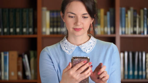 portrait of stylish pretty business woman smiling using smartphone for texting Footage