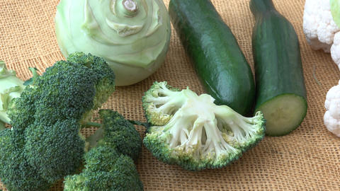 Assortment green vegetables. Broccoli, cauliflower, kohlrabi, cucumber, leek. Healthy eating GIF