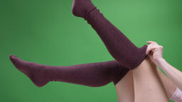 Closeup shoot of female teenage legs in cute red white socks playfully moving Footage