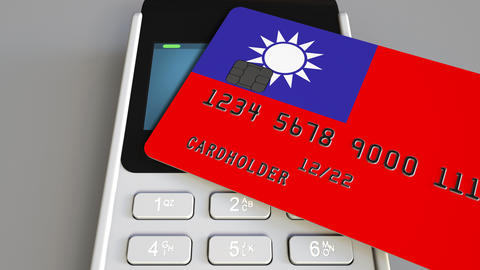 Paying with credit card with flag of Taiwan. Taiwanese retail sales or banking Footage