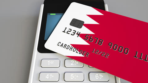 Paying with credit card with flag of Bahrain. Bahraini retail sales or banking Footage