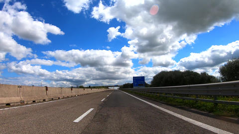 Drive lapse driving in a beautiful cloudy and sunny day on a freeway Live Action