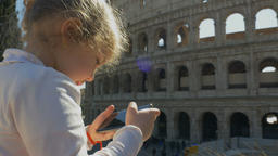 A child takes a photo of the sights of Rome Footage
