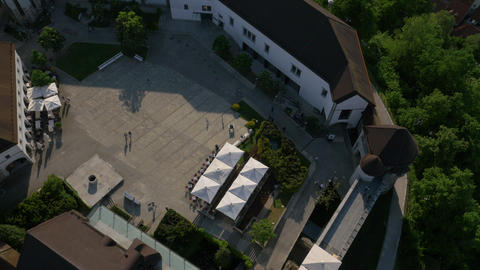 Aerial - Top view of Ljubljana Castle's courtyard with a restaurant Footage