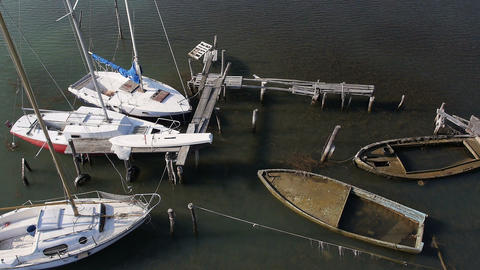 Aerial - Old and abandoned sailboat dock Footage