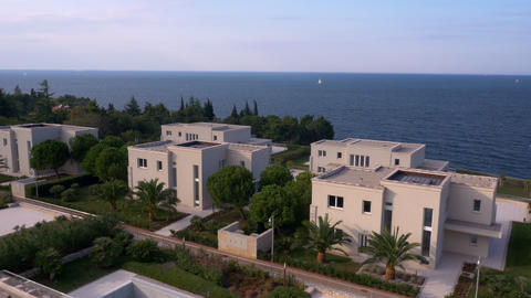 Aerial - Flyover luxury villas at the seaside Live Action