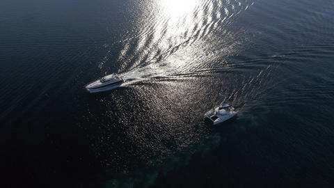 Aerial - Luxury yacht and catamaran sailing on the sea Footage