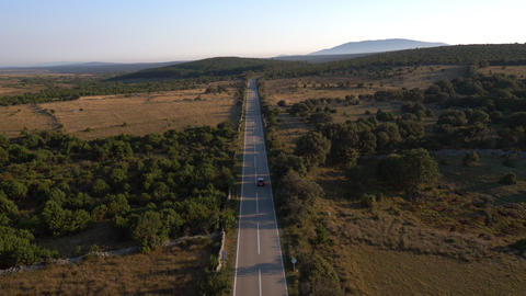 Aerial - High angle view of two cars driving on road Footage