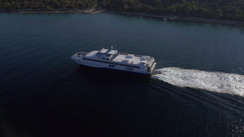 Aerial - Water public transport, fast ferry cruising through the channel Footage