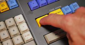 An Editor Presses Mark In and Mark Out Buttons on an Edit Controller Footage